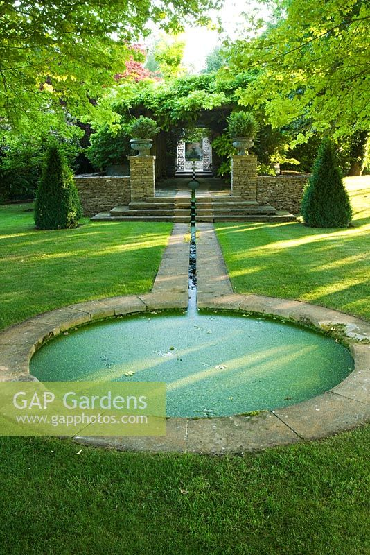 Gap gardens rill leading to circular pond from stone for Circular garden ponds