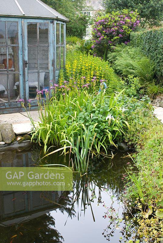 Gap Gardens Wooden Blue Summer House In Cottage Garden