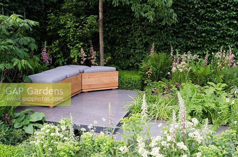 Polished Concrete Patio With Seating Area And Carpinus   Hornbeam Hedging  In U0027The Lands End