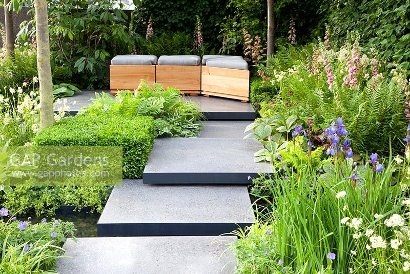 Gap gardens polished concrete pads form stepping stones across stream in 39 the lands end across - Chelsea flower show gold medal winners ...