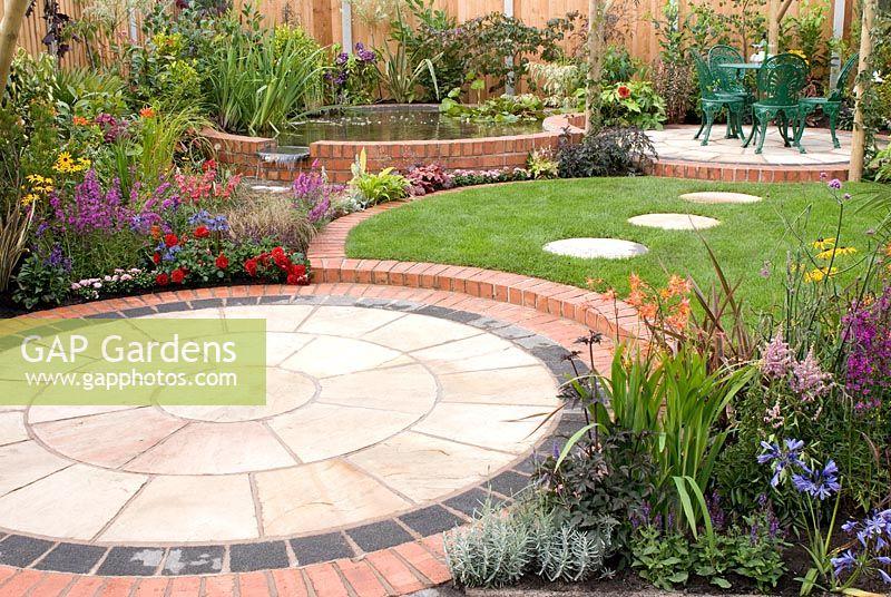 Gap gardens small back garden with colourful borders for Circular flower garden designs
