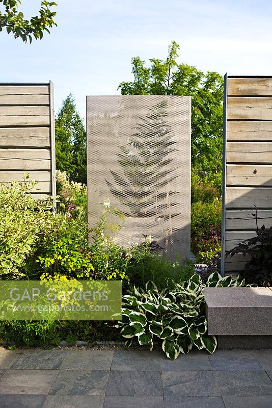 Concrete wall and wooden fences in modern garden