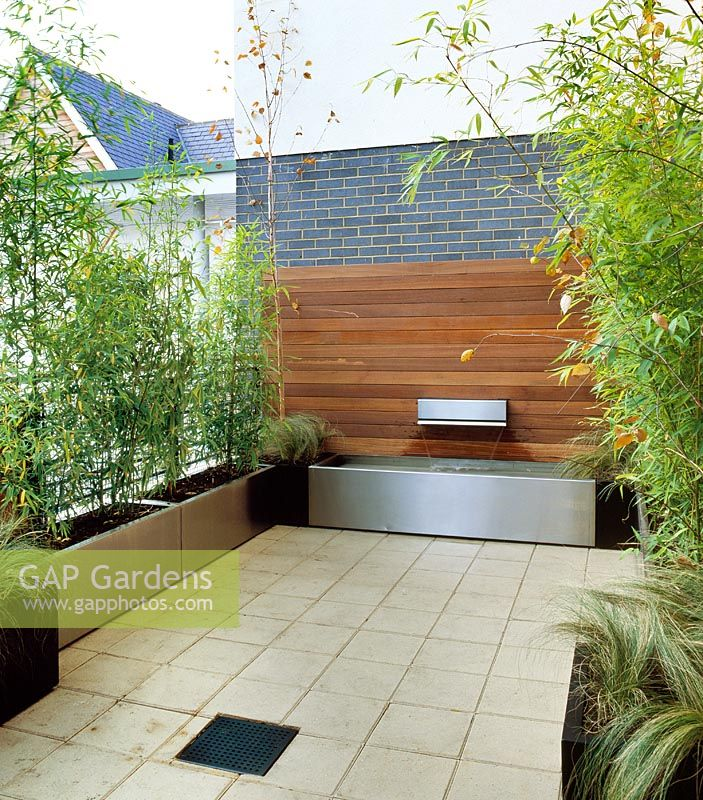 Modern Roof Terrace With Waterfeature And Metal Planters Planted Bamboo