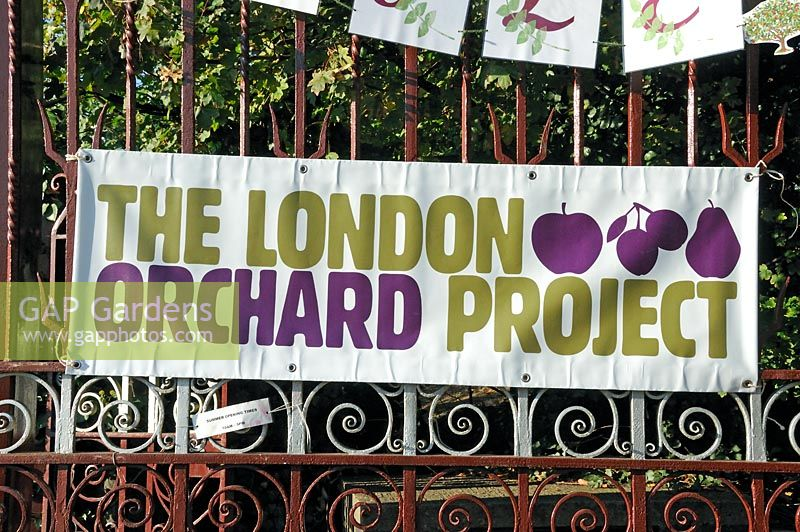 London Orchard Project sign displayed on the entrance gates to Camley Street Natural Park for apple day, King's Cross, London Borough of Camden, London, UK