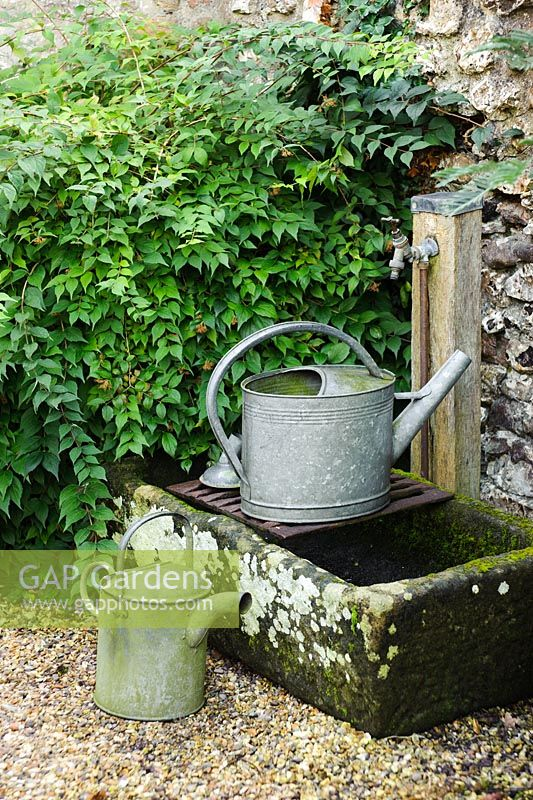 Outdoor Stone Sink : Gardens - Watering cans beside outdoor tap mounted over old stone sink ...