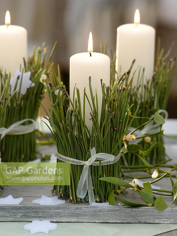 Candle holders made from pine needles