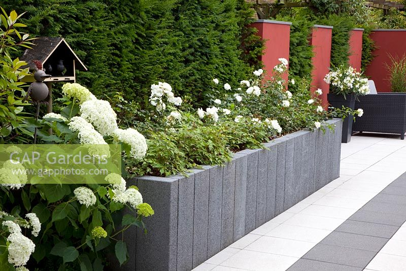 Gap Gardens Modern Paved Garden With Raised Beds Of
