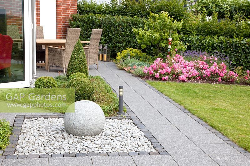 Modern Water Feature And Topiary On Patio