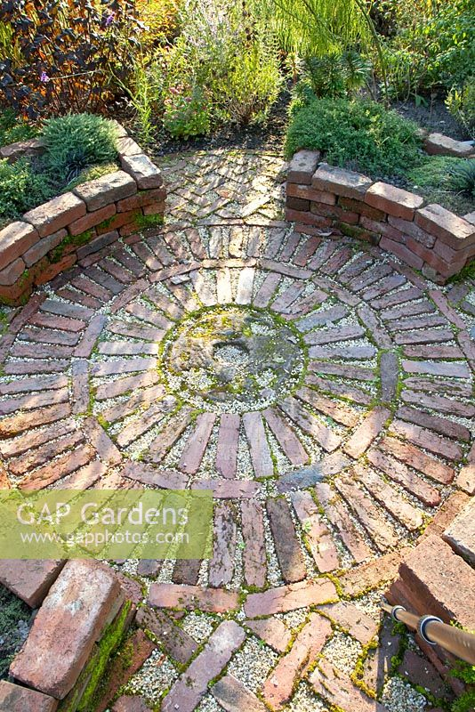 Circular Brick Patio In Herb Garden