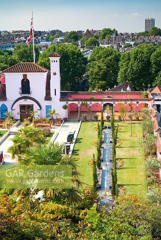 View of The Spanish Garden at The Roof Gardens, Kensington with city beyond