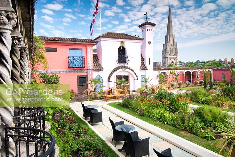 View of The Spanish Garden at The Roof Gardens, Kensington, with St. Mary Abbots Church beyond