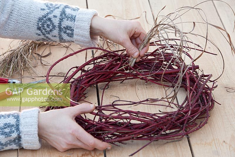 Making Christmas wreaths - adding grass strands