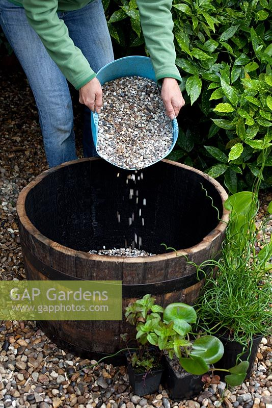 Creating a water feature - adding gravel to base of wooden barrel