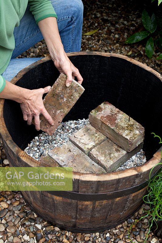 Creating a water feature - adding a brick layer on top of gravel