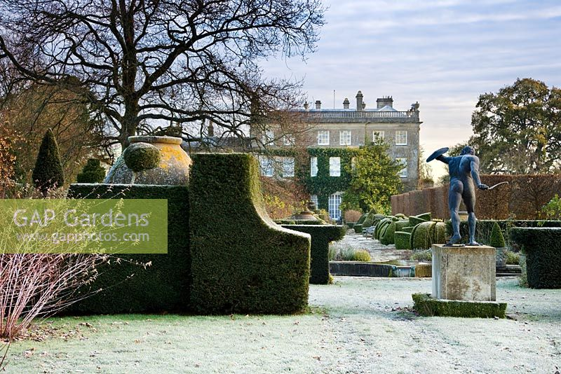 Winter frost in Highgrove Garden, looking towards the House, Borghese Gladiator and Thyme Walk. December 2007.