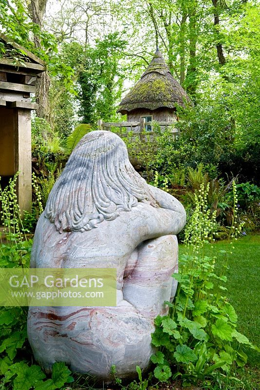 The Stumpery with a statue 'Goddess of the Woods', and the tree house - Highgrove Garden, May 2008.