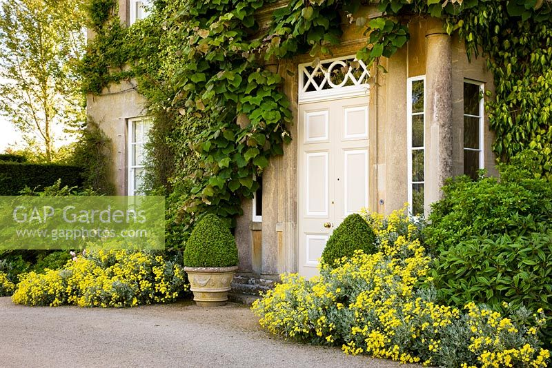 The North East Front of Highgrove House, with pots and flowers, June 2008. The house built between 1796 and 1798 in georgian neo - classical design.