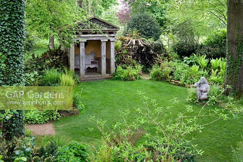 The Stumpery, Temple and 'Goddess of the Woods' statue, from the Tree House. Highgrove Garden, June 2008.