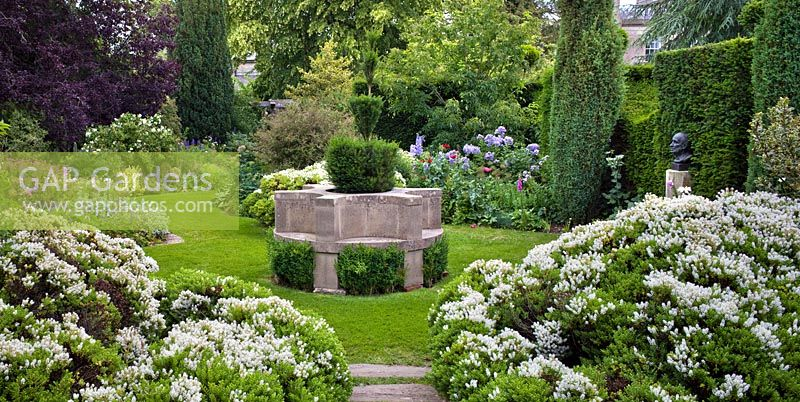 The Cottage Garden with circular stone seat, Highgrove Garden, June 2011.