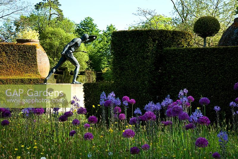 Spring wild flowers and bronze Borghese Gladiator. Highgrove Garden, May 2010.