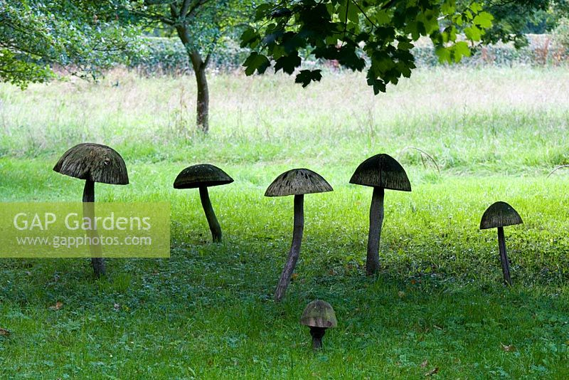 Wooden Toadstool Sculptures in the Stumpery, August 2007.
