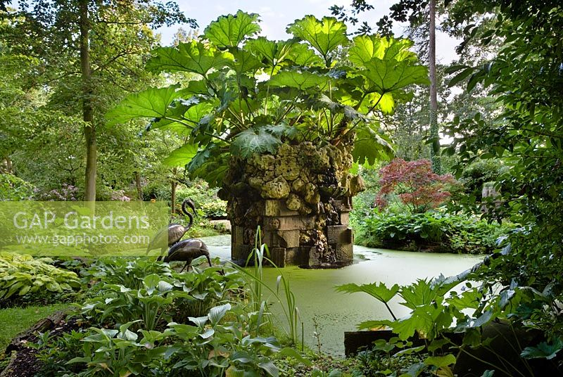 The Water Feature with Gunnera - Giant South American Rhubarb in the Stumpery, Highgrove August 2007. The water feature is made of Hereford red sandstone and Spanish limestone.