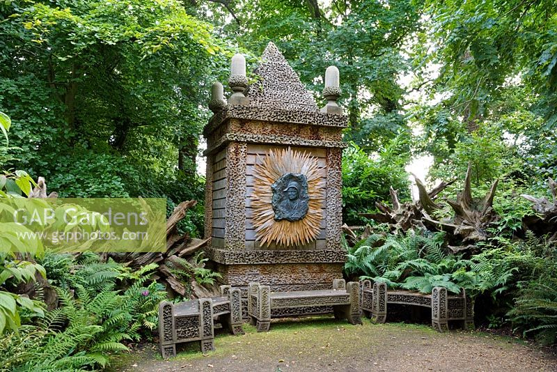 The Temple of Worthies in the Stumpery with a bronze relief of The Queen Mother in the centre. Highgrove Garden, August 2007.