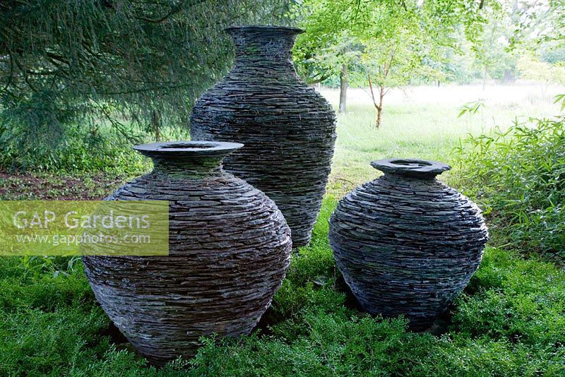 Large slate pots on the edge of the Wild Flower Meadow. These were made using a technique akin to dry stone walling.