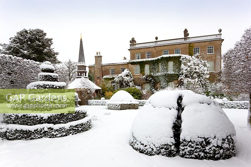 The west front from The Thyme Walk with the Oak Pavillion, covered in snow, Highgrove Garden, January 2010.