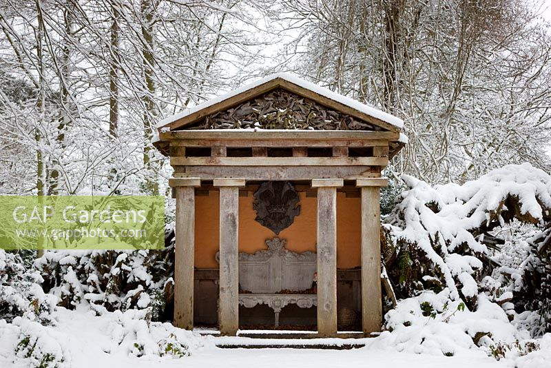 Temple in the the Stumpery made of green oak in snow, Highgrove Garden, January 2010.