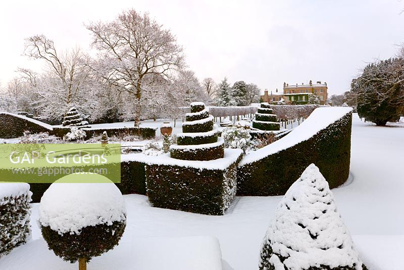 The west front and topiary in snow, Highgrove, January 2010.