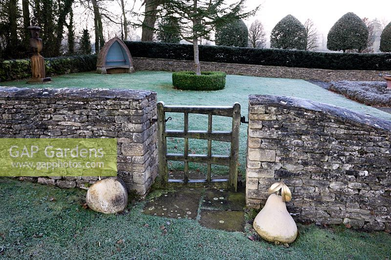 The Gate from The Orchard Room with gold coloured Apple and Pear sculptures, Highgrove Garden, December 2008.