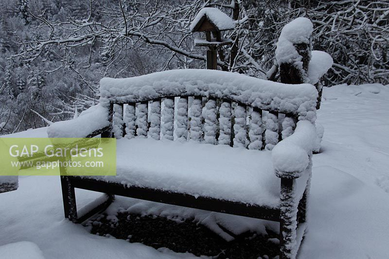 Garden seat with heavy snow covering