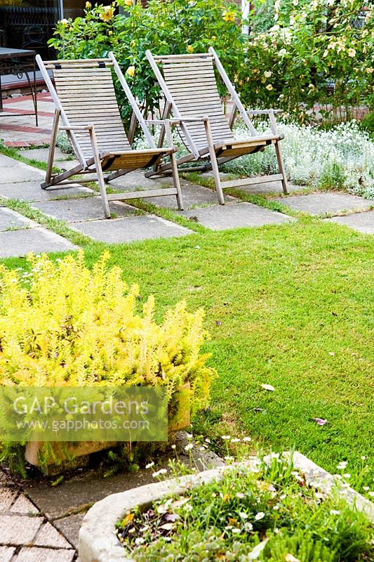 Gap gardens pair of wooden recliners on terrace with for Terrace farming model