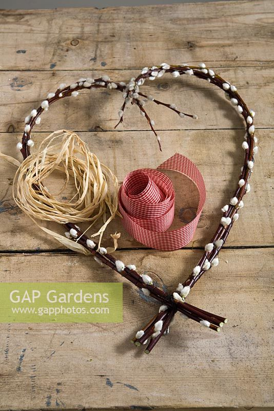 Step-by-step - Attaching ribbon and thread - making heart shaped decoration using Salix caprea, pussy willow