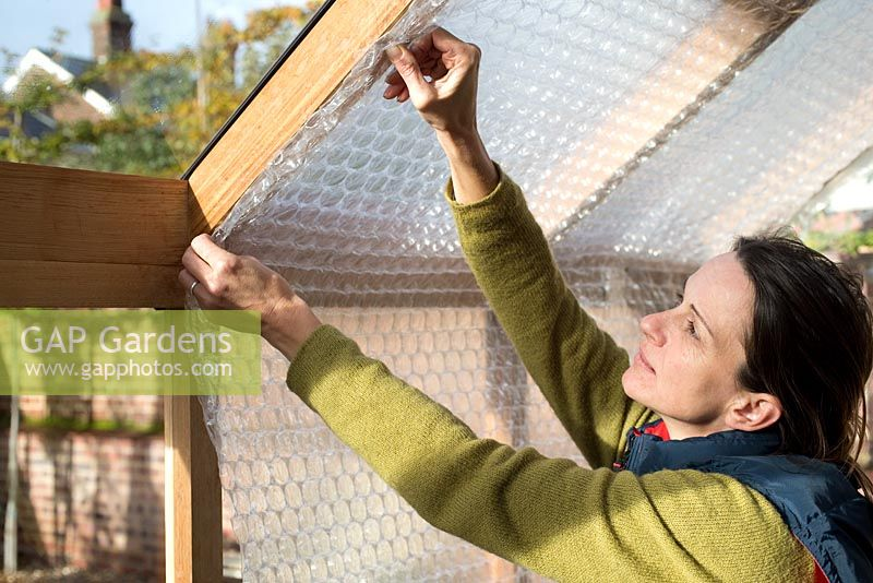 Step-by-step - Attaching bubble wrap to interior of greenhouse