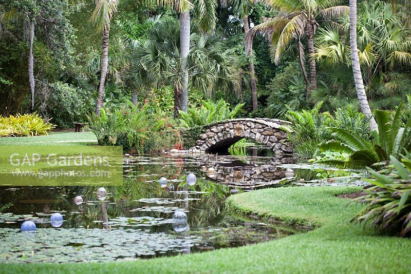 The Stone Bridge Over The Waterlily Pond At McKee Botanical Garden, Vero  Beach, Florida