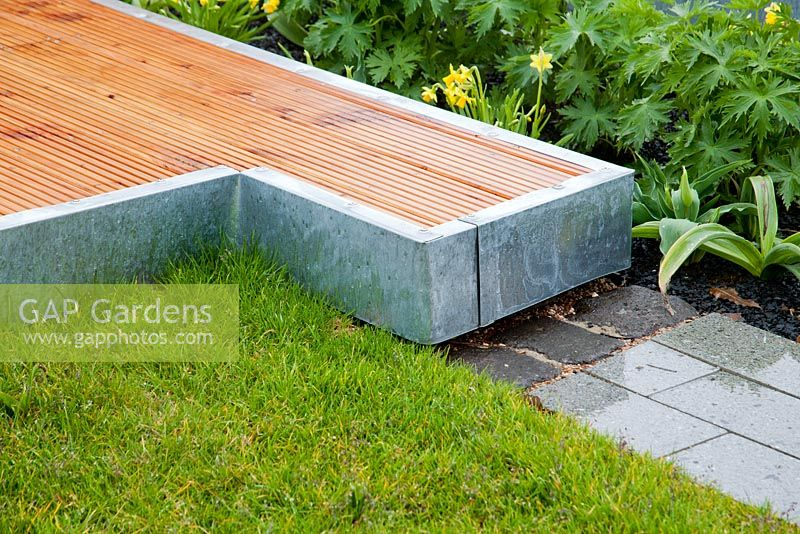 Wooden deck with galvanised metal edge