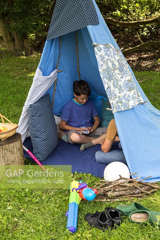 Childrens teepee in garden setting