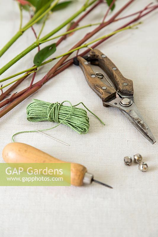 Tools and materials include bradle, dogwood - Cornus, secateurs, needle, thread and bells