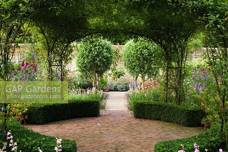 GAP Gardens - Rose arches at the centre of the walled garden are ...