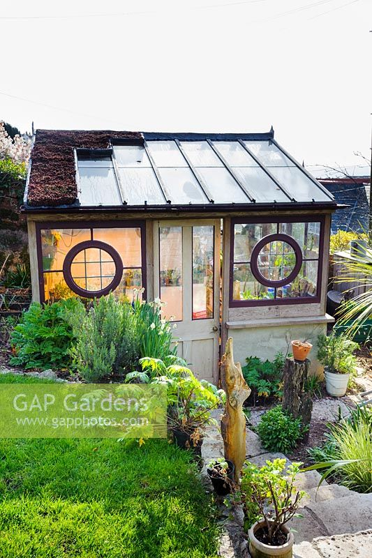 Lean to greenhouse made from architectural salvage building materials by Toby Buckland