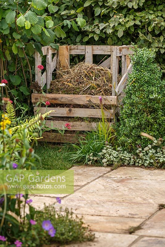 Wooden compost bin and stone paving, The Visible Garden, RHS Hampton Court Flower Show 2014