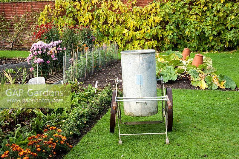 GAP Gardens - Vintage water carrier in autumn walled vegetable ...