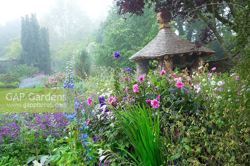 The new Summerhouse in the Cottage Garden, a place for the Prince to workwhilst avoiding showers. September 2013.