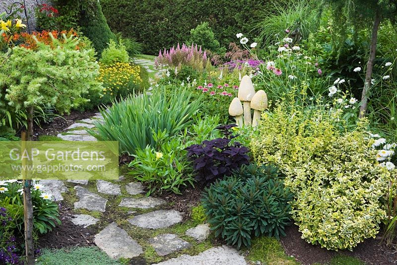 GAP Gardens Flagstone path and border planted with purple