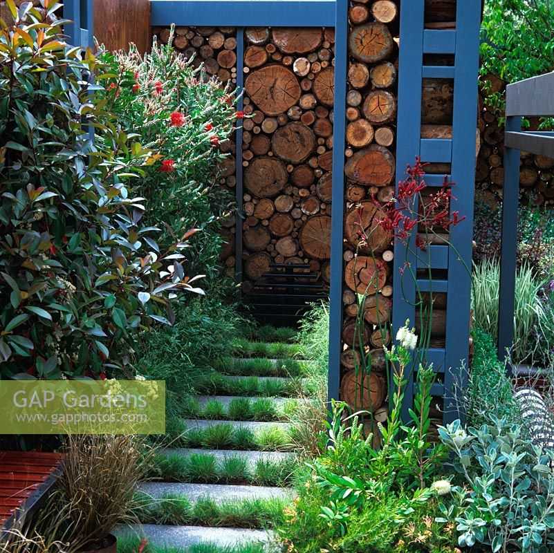 Unusual Wall With Rustic Feel Created From Sawn Timber At End Of Secret  Passage. Grasses