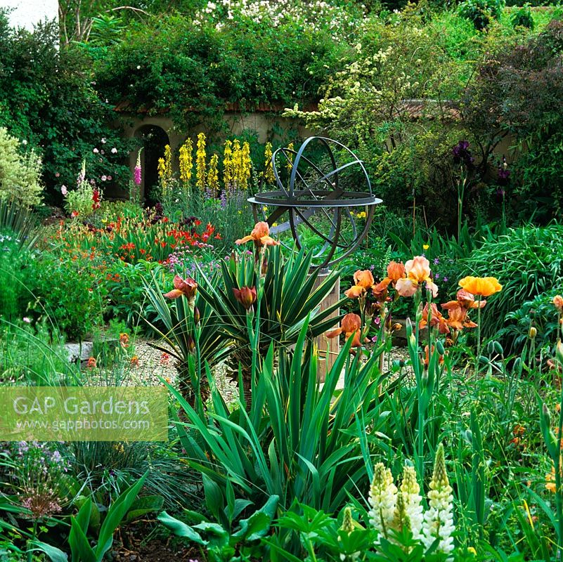 Mediterranean Style, Walled Garden. Armillary Sphere. Beds Of Papaver  Turkish Delight, Rosa