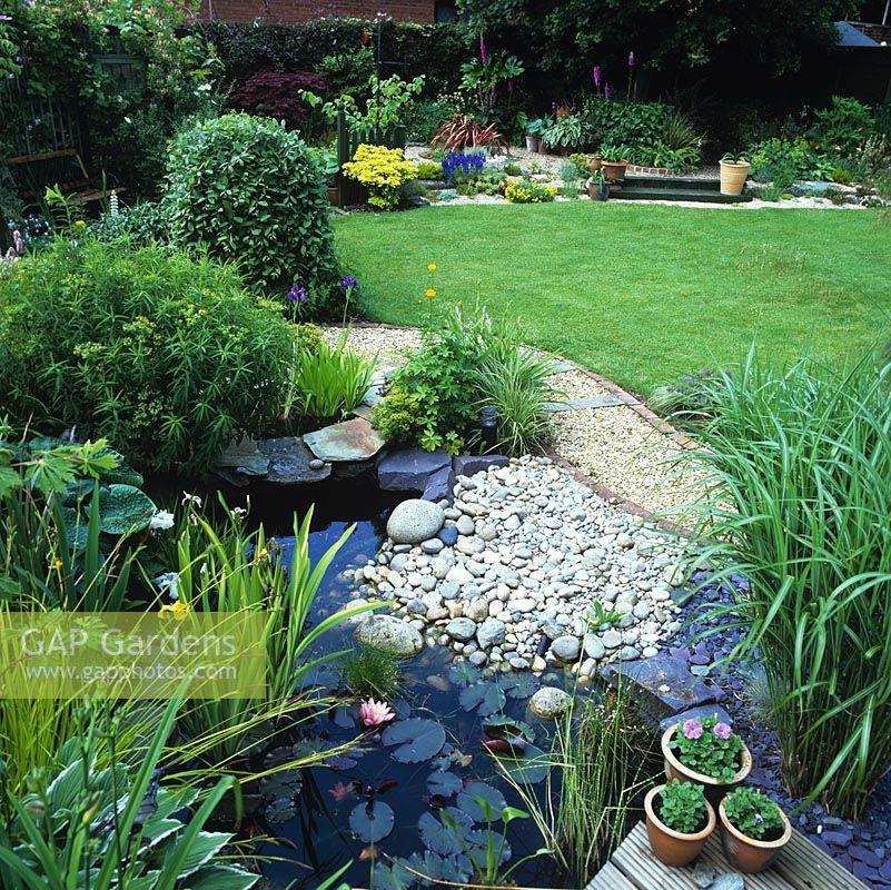 Gap gardens back garden 16m square with gravel and for Garden pond gravel