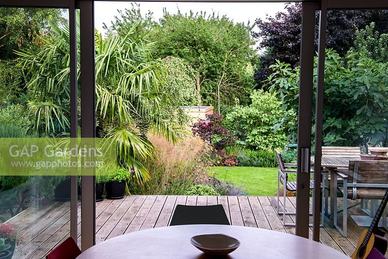 The view from the kitchen of St. Mary's walk, a 30' x 15' terraced garden on a sloping site.